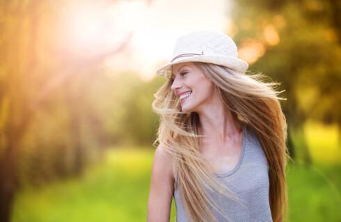 PÅVIRKER OGSÅ HÅRET: Av de samme årsakene som med neglene, så vokser også håret raskere på sommeren.  Foto: Halfpoint - Fotolia