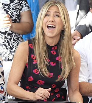 IKONISK SVEIS: Hollywood-skuespiller Jennifer Aniston er kjent for sine lange lokker. Foto: NTB Scanpix