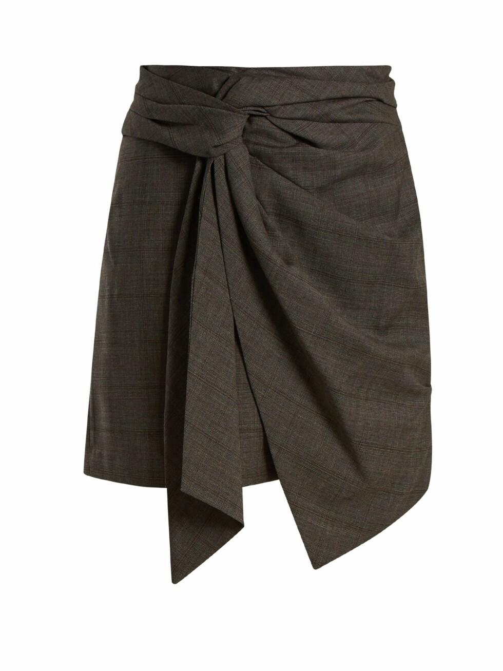 Skjørt fra Isabel Marant via Matchesfashion.com  1945,-  https://www.matchesfashion.com/intl/products/Isabel-Marant-%C3%89toile-Nima-knot-detail-checked-wool-mini-skirt--1165332