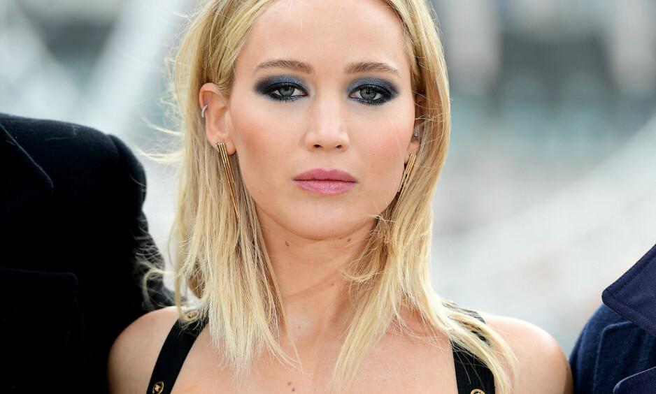 JENNIFER LAWRENCE: Jennifer Lawrence er ikke redd for å si hva hun synes om oppstyret rundt premierekjolen hennes. Foto: NTB Scanpix
