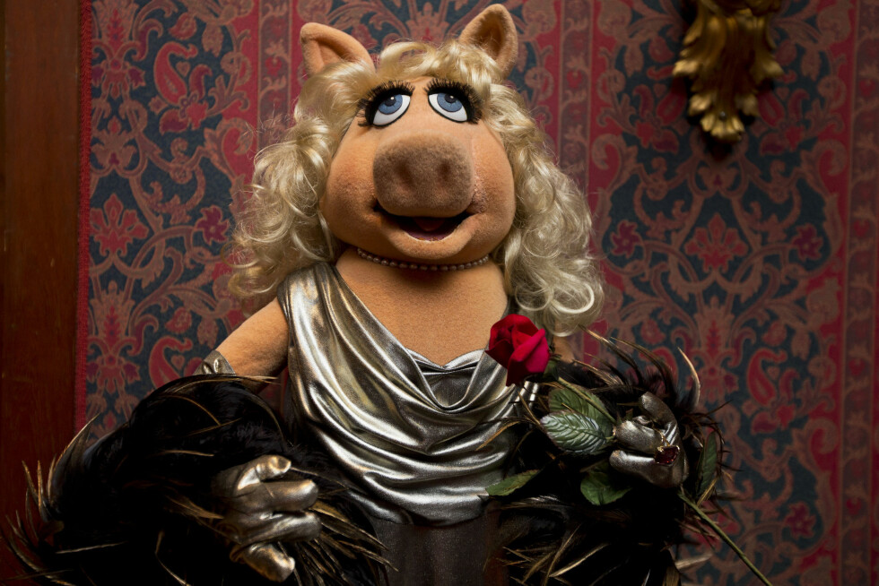 """A Miss Piggy muppet, that was used on """"The Muppet Show,"""" is all dressed up during a ceremony to donate additional Jim Henson objects to the Smithsonian's National Museum of American History in Washington, Tuesday, Sept. 24, 2013. Miss Piggy is finally joining Kermit the Frog in the Smithsonian Institution's collection of Jim Henson's Muppets, and Bert and Ernie will have a place in history, too. Henson's daughter, Cheryl Henson, is donating 20 more puppets and props to the National Museum of American History. (AP Photo/Jacquelyn Martin)"""