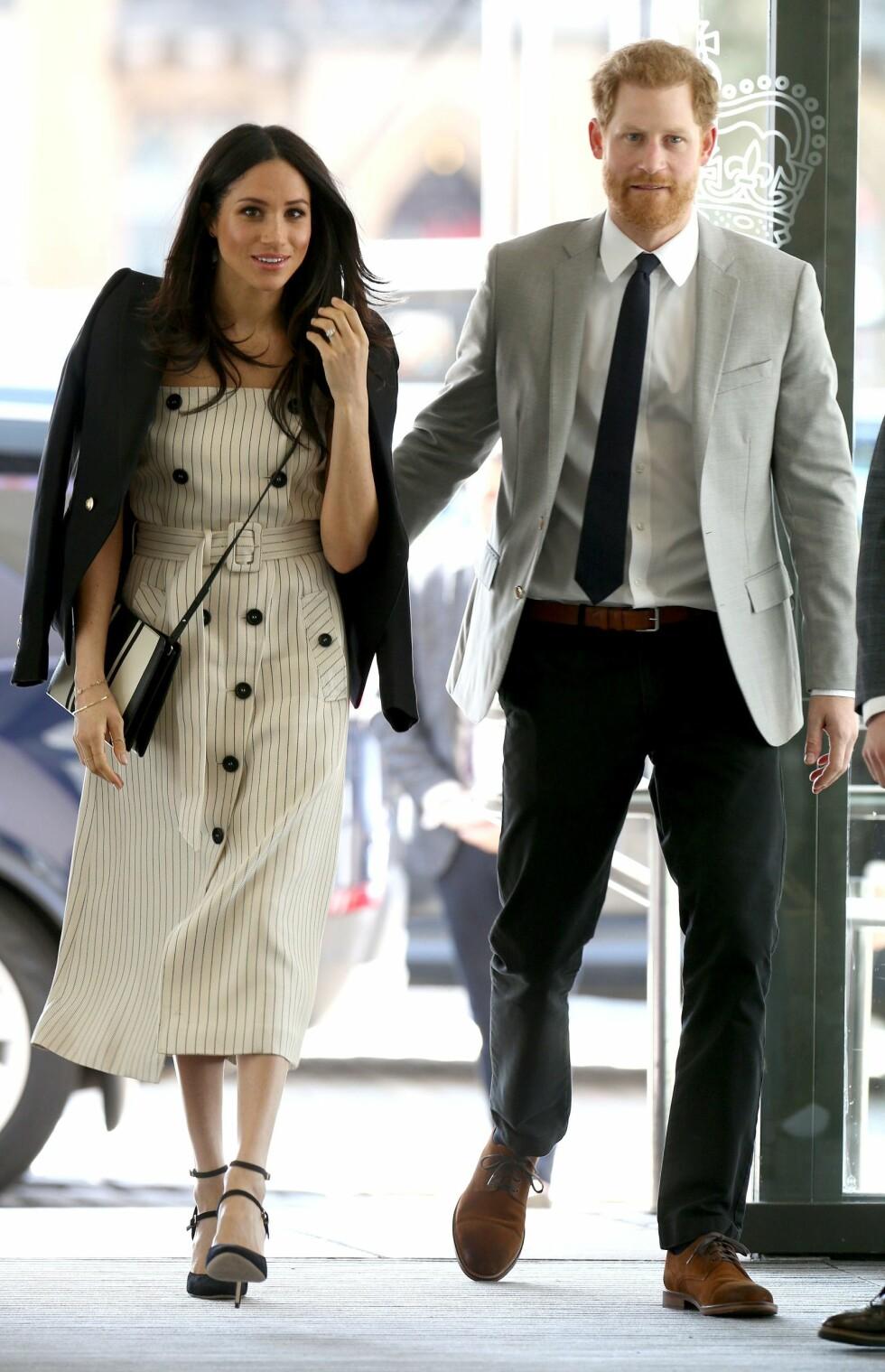 <strong>STØTTER FORLOVEDEN:</strong> Prins Harry og Meghan Markle fotografert samme dag som hennes halvsøster kom med krass kritikk om paret på sosiale medier. FOTO: NTB Scanpix