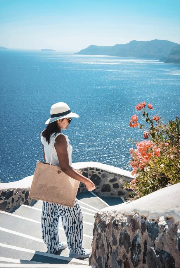 SANTORINI: Denne perlen oser av kjærlighet, og det er lett å skjønne hvorfor nygift fra hele verden reiser til den greske øya på bryllupsreise. FOTO: NTB scanpix