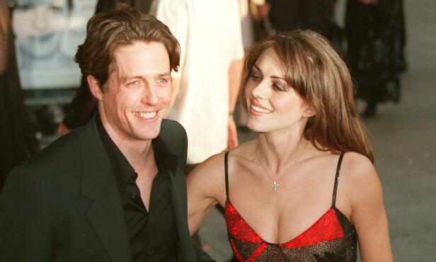 GODE VENNER: Hugh Grant og den britiske skuespilleren Elizabeth Hurley var kjærester fra 1987 til 2000. Eksene har beholdt det gode vennskapet. Dette bildet er fra Notting Hill-premieren i 1999. FOTO: NTB Scanpix