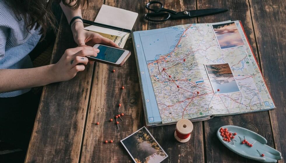 PLANLEGG: God planlegging kan gjøre ferien lettere for lommeboka. Glem heller ikke å sette opp et reisebudsjett. FOTO: NTB Scanpix