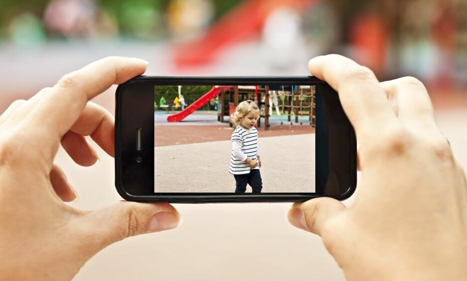 BRUK AV APP I BARNEHAGER OG SKOLER: Det blir alt vanligere at skoler og barnehager benytter seg av apper i sin kommunikasjon med foreldrene. FOTO: NTB Scanpix