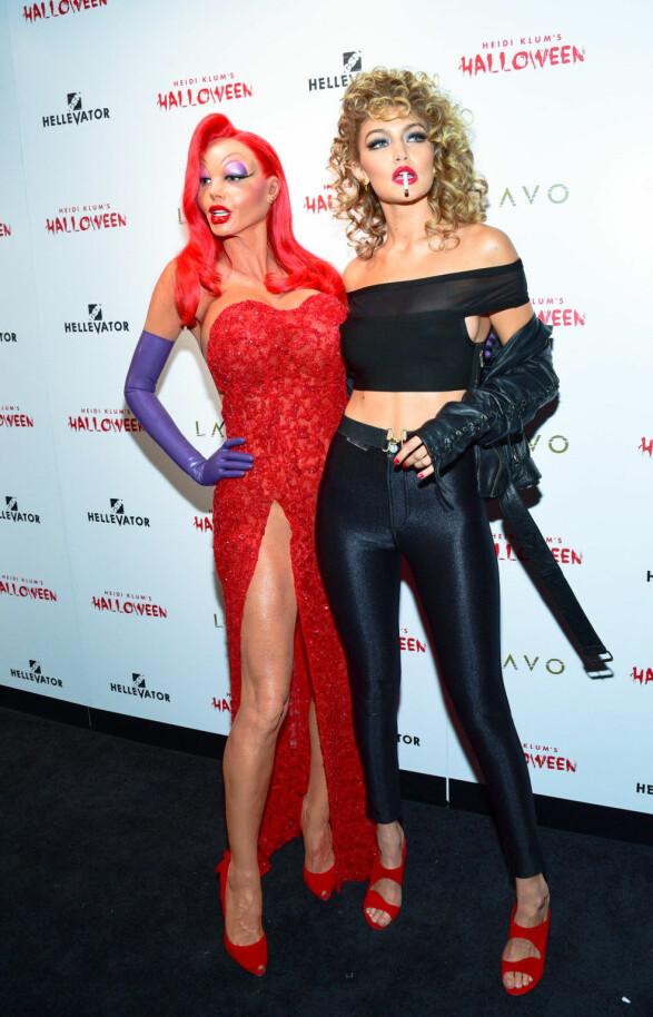 SUPERMODELLER: Vi kunne se at det var Gigi Hadid som hadde kledd seg ut som Sandy fra Grease, men at det var Heidi Klum som gjemte seg bak det andre kostymet, hadde vi aldri trodd! Foto: SipaUSA