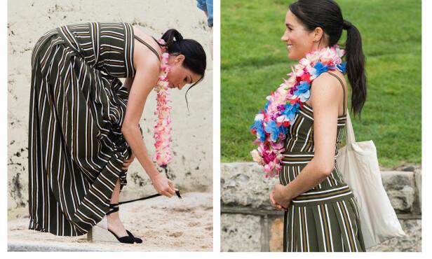 MAGEN VOKSER: Hertuginne Meghan strøk seg over sin voksende babymage under besøket til Bondi Beach i Australia i slutten av oktober. Hun benyttet også anledningen til å kaste hælene for å gå barbeint i den deilige sanden. FOTO: NTB Scanpix