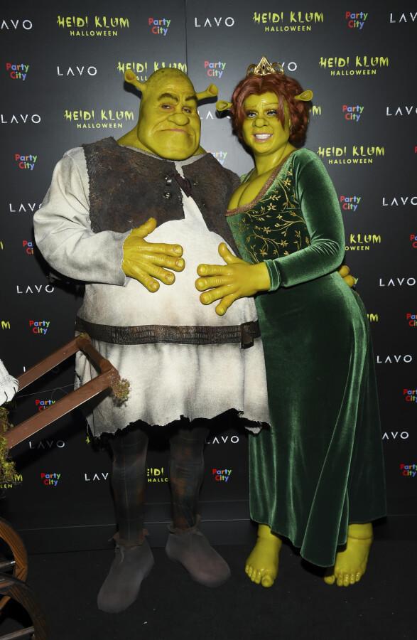 IKKE TIL Å KJENNE IGJEN: Tom Kaulitz (t.v.) og Heidi Klum (t.h.) hadde kledd seg ut som Shrek og Fiona. Foto: Scanpix