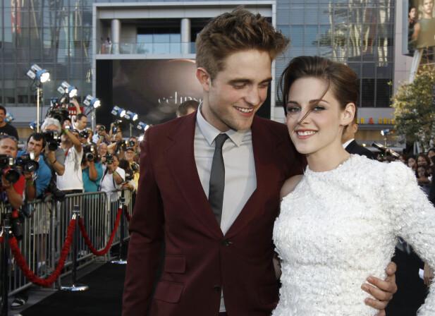 TATT PÅ FERSKEN: Forholdet mellom Robert Pattinson og Kristen Stewart tok slutt da sistnevnte ble fotografert i het omfavnelse med en annen mann. FOTO: Scanpix