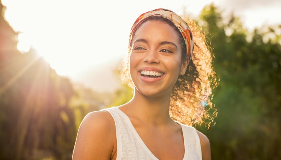 <strong>SMIL:</strong> Det å smile kan ha en forsterkende effekt på godt humør. FOTO: NTB Scanpix