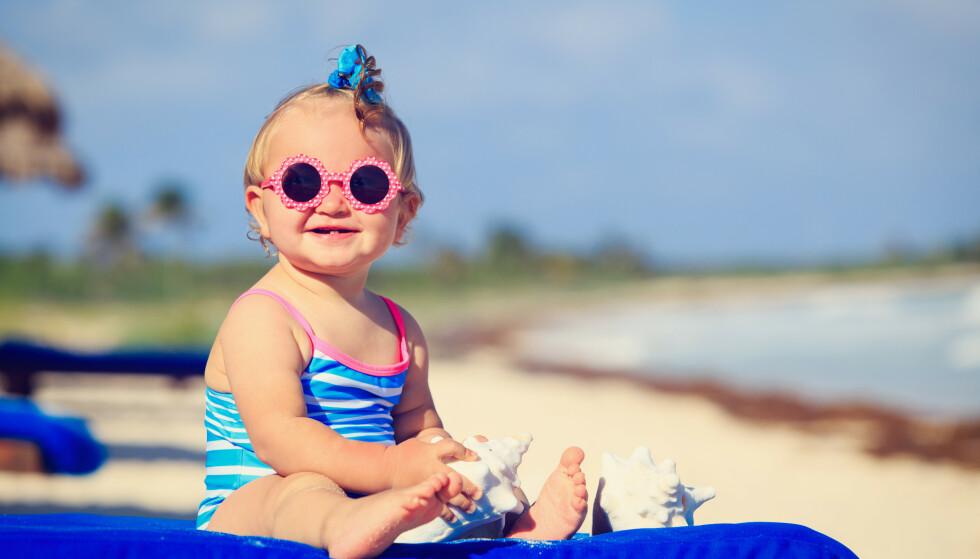 RISIKO: Visste du at barn som blir solbrente har større sjanse for å få hudkreft som voksne? FOTO: NTB Scanpix