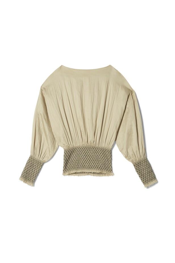 Bluse med strikk (kr 3100, Totême). FOTO: Produsenten