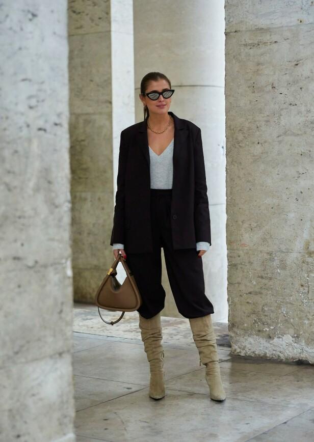 KUL STYLING: Legg merke til hvordan buksen er stappet ned i støvlettene. Foto: Scanpix
