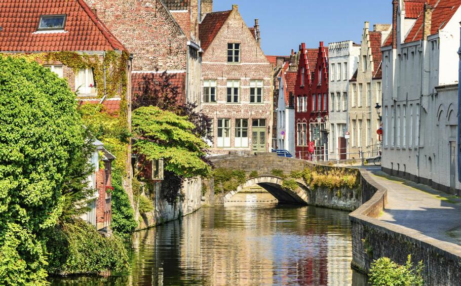 BRUGGE I BELGIA: Byens mange kanaler er en av byens store attraksjoner. FOTO: NTBScanpix