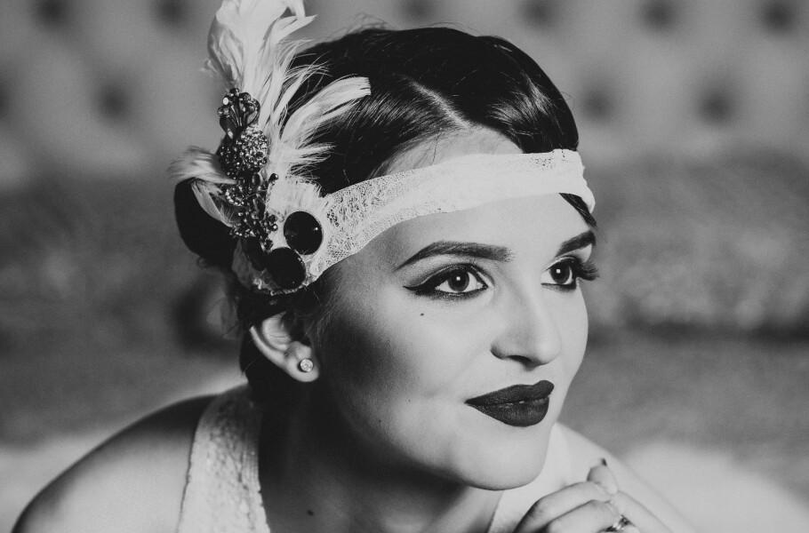 <strong>1920-TALLET:</strong> Håret var kort og glamrøst, og dekorert med alt fra fjær til perler. FOTO: NTB Scanpix
