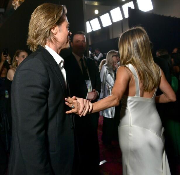 GJENFORENT: Ikke la henne gå, Brad! Foto: NTB Scanpix