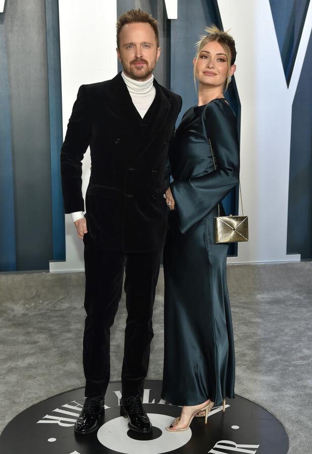 TURTLE-NECK: Breaking Bad skuespiller Aaron Paul (40) og kona Lauren Parsekian (33). FOTO: NTB Scanpix