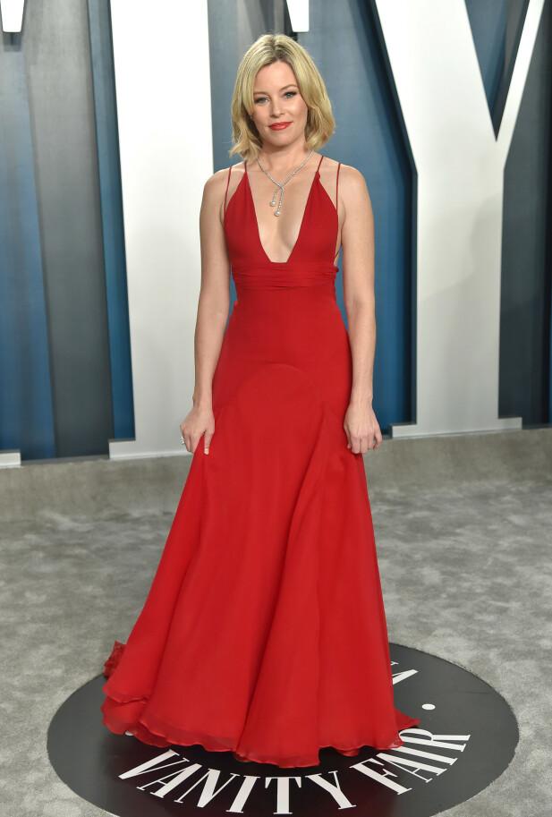 GJENBRUK: Elizabeth Banks hadde på seg den samme røde kjolen i 2020 som hun hadde på seg for 16 år siden på en Oscars-fest. FOTO: NTB scanpix