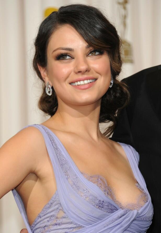 SMAKEN ER SOM BAKEN: Mila Kunis på Oscarutdelingen i 2011. Hun har spilt i flere filmer hvor hun har jobbet med en body double. FOTO: NTBScanpix.