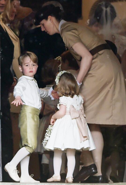 <strong>PASSET PÅ:</strong> Barnepike Maria Borrallo med det royale søskenparet George og Charlotte under tante Pippa Middletons bryllup i 2017. FOTO: NTB scanpix