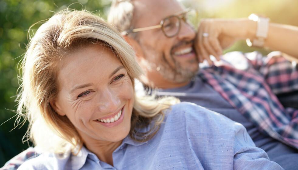 TRYGG GRUNN: Noen forhold ser ut til å tåle alt. Forskere mener de har funnet ingrediensen til hva som gjør at par føler seg lykkelige. FOTO: NTBScanpix