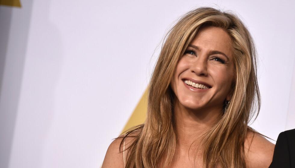 TRENING: Den amerikanske skuespilleren Jennifer Aniston er opptatt av trening og sunt kosthold, men er også for at man skal unne seg å skeie ut innimellom. FOTO: NTB