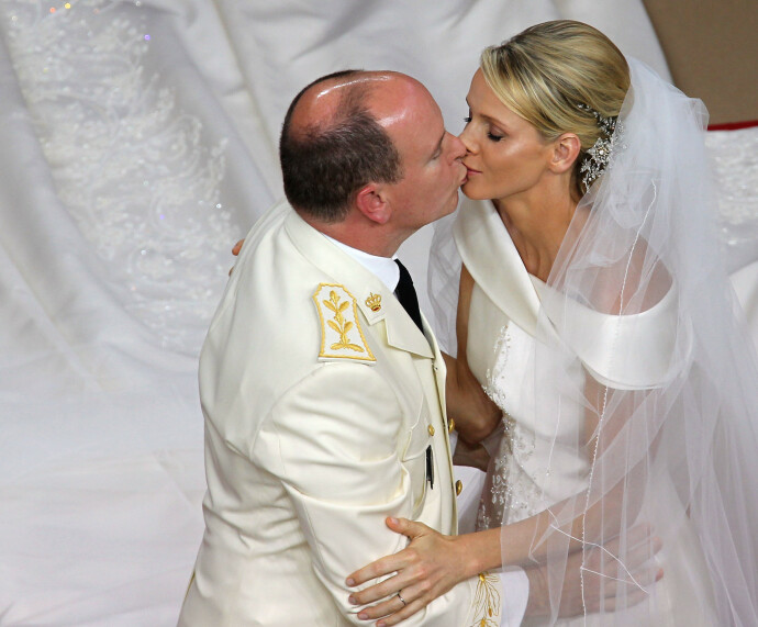 AFP PICTURES OF THE YEAR 2011 Prince Albert II of Monaco kisses Princess Charlene of Monaco during their religious wedding at the Main Courtyard of the Prince's Palace on July 2, 2011 in Monaco.  AFP PHOTO / VALERY HACHE