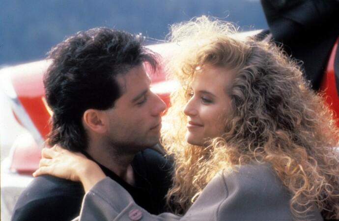 SOM RETT UT AV EN FILM: Stjerneparet Kelly Preston og John Travolta møttes under innspillingen av «The Experts» i 1987. Tre år senere giftet de seg. FOTO: NTB