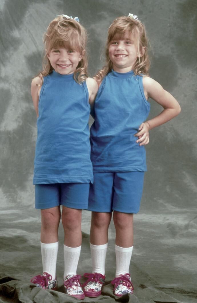 DOBBELTROLLE: Ashley Olsen og Mary-Kate Olsen delte på rollen i «Under samme tak», ettersom lovgivningen kun tillot barn å jobbe et begrenset antall timer foran kamera. FOTO: NTB
