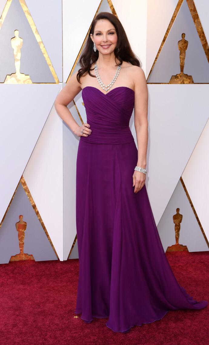 FRA ASKEN TIL ILDEN: Ashley Judd under Oscar-galaen i 2018. Tre år senere holdt hun på å miste livet i jungelen i Kongo FOTO: NTB