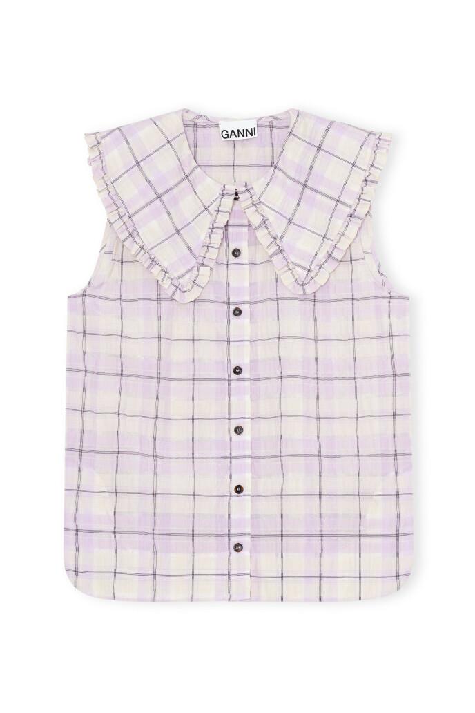 Ermeløs skjorte (kr 1395, Ganni).