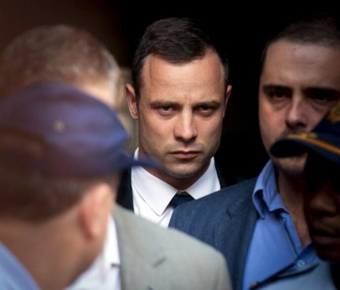 PLANLAGT?: Var Oscar Pistorius en notorisk drapsmann, eller bare svært uheldig? Her fra da han forlot retten i Pretoria i mars 2014. FOTO: NTB