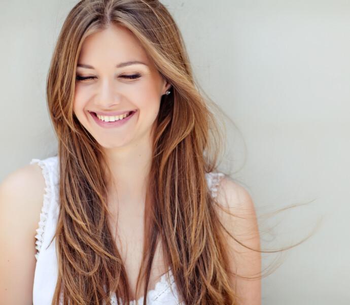 SMIL TIL VERDEN: Det er ikke bare gapskratt som er bra for helsa. Også jovial munterhet skal være bra. FOTO: NTB
